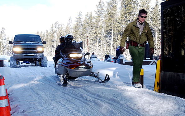 Snowmobilers Ride At Yellowstone National Park