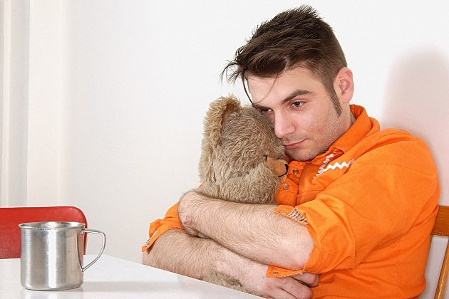 depressed guy holding a bear